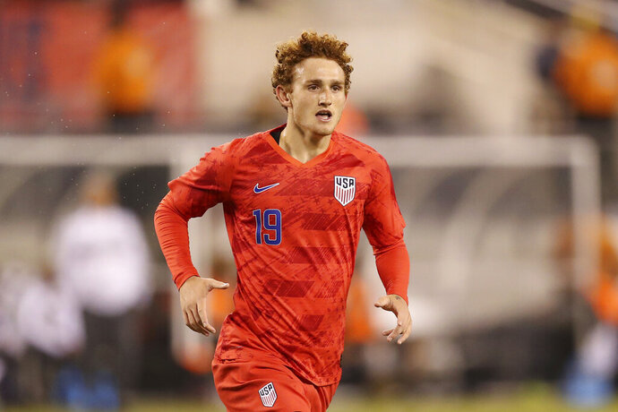 FILE - In this Sept. 6, 2019, file photo, United States forward Josh Sargent runs up the pitch during an international friendly soccer match against Mexico, in East Rutherford, N.J. Sargent hopes to play for the United States in his hometown during Tuesday's exhibition against Uruguay at Busch Stadium.  (AP Photo/Steve Luciano, File)