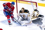 Boston Bruins goaltender Tuukka Rask makes a save against Montreal Canadiens' Nate Thompson as Bruins' Danton Heinen watches during the second period of an NHL hockey game Tuesday, Nov. 5, 2019, in Montreal. (Paul Chiasson/The Canadian Press via AP)