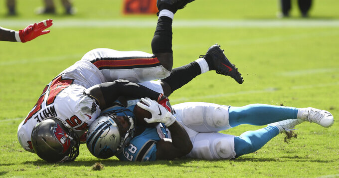 Carolina Panthers running back Mike Davis (28) gets taken down by Tampa Bay Buccaneers linebacker Devin White during the second half of an NFL football game Sunday, Sept. 20, 2020, in Tampa, Fla. (AP Photo/Jason Behnken)