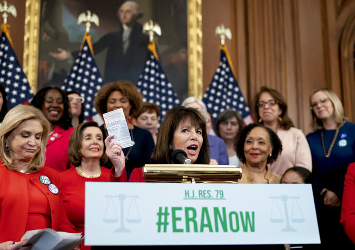 Rep. Jackie Speier, D-Calif., joined from left by Rep. Carolyn Maloney, D-N.Y., and Speaker of the House Nancy Pelosi, D-Calif., and other congressional Democrats, holds up a copy of the Constitution during an event about their resolution to remove the deadline for ratification of the Equal Rights Amendment. at the Capitol in Washington, Wednesday, Feb. 12, 2020. (AP Photo/J. Scott Applewhite)