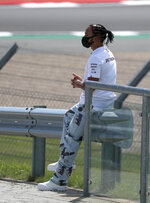 Mercedes driver Lewis Hamilton of Britain sits on the side of the track ahead of the British Formula One Grand Prix at Silverstone circuit, Silverstone, England, Thursday, July 30, 2020.(AP Photo/Frank Augstein)