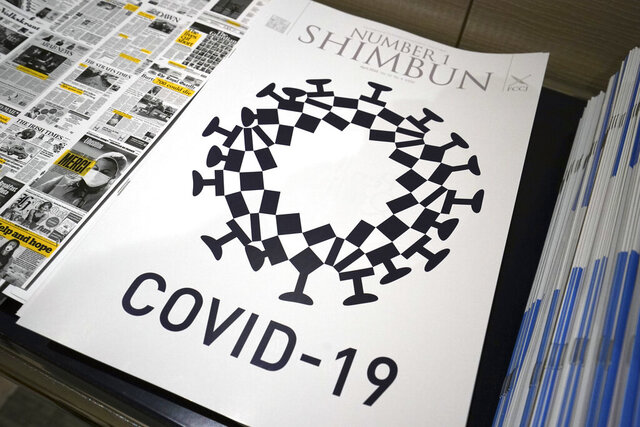 "The cover design of Number 1 Shimbun is seen in Tokyo, Tuesday, May 19, 2020. Tokyo Olympics officials are incensed that their games emblem has been used in the cover design of the local magazine that combines the logo with the novel coronavirus. The ""look-alike""emblem, which had ""COVID-19"" written underneath, was published on the cover the the April issue of the Foreign Correspondents Club of Japan's magazine. It also appeared in an online edition. (AP Photo/Eugene Hoshiko)"