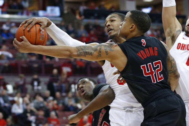 Ohio State's Kaleb Wesson, left, blocks the shot of Rutgers' Jacob Young during the first half of an NCAA college basketball game Wednesday, Feb. 12, 2020, in Columbus, Ohio. (AP Photo/Jay LaPrete)