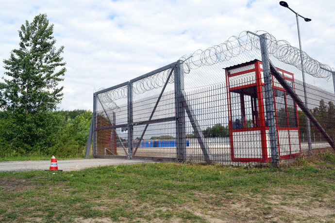 A general view of the transit zone for asylum seekers in Roszke, Hungary, Tuesday, May 7, 2019. Hungary has deported a family of six asylum-seekers to Serbia, making them cross a gate in the border fence in the dark, with no one waiting for them on the Serbian side. A Hungarian human rights group said they had secured an interim measure to stop the deportation of one of two other families awaiting a similar fate. (AP Photo/Pablo Gorondi)