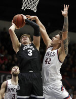 Gonzaga's Filip Petrusev (3) shoots as St. Mary's Dan Fotu (42) defends during the first half of an NCAA college basketball game Saturday, Feb. 8, 2020, in Moraga, Calif. (AP Photo/Ben Margot)