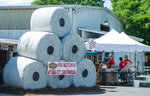 A whimsical display fashioned like giant high-demand toilet paper rolls draws attention to Hub City Smokehouse's curbside service on Main Street in historic downtown Crestview, Fla., Tuesday, April 7, 2020. (Michael Snyder/Northwest Florida Daily News via AP)