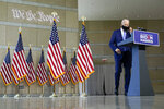 Democratic presidential candidate and former Vice President Joe Biden removes his face mask to begin speaking at the Constitution Center in Philadelphia, Sunday, Sept. 20, 2020, about the Supreme Court. (AP Photo/Carolyn Kaster)