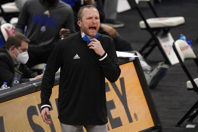 Drake head coach Darlan DeVries is seen on the sidelines during the second half of an NCAA college basketball game against Missouri State in the semifinal round of the Missouri Valley Conference men's tournament Saturday, March 6, 2021, in St. Louis. (AP Photo/Jeff Roberson)