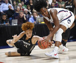 FILE - In this March 11, 2019, file photo, Central Florida's Kayla Thigpen, left, and Connecticut's Christyn Williams reach for the ball during the first half of an NCAA college basketball game in the American Athletic Conference women's tournament finals at Mohegan Sun Arena in Uncasville, Conn. Final plans were announced Thursday, Nov. 12, 2020, for 11 days of college basketball in November inside a modified bubble at the Mohegan Sun resort casino. (AP Photo/Jessica Hill, File)