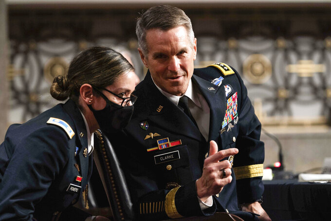 Special Operations Command Gen. Richard Clarke speaks to his staff during a hearing to examine United States Special Operations Command and United States Cyber Command in review of the Defense Authorization Request for fiscal year 2022 and the Future Years Defense Program, on Capitol Hill, Thursday, March 25, 2021, in Washington. (Anna Moneymaker/The New York Times via AP, Pool)