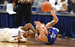 Connecticut's Christian Vital, left, and Tulsa's Lawson Korita, right, dive for the ball in the first half of an NCAA college basketball game, Sunday, Jan. 26, 2020, in Hartford, Conn. (AP Photo/Jessica Hill)