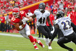 Kansas City Chiefs tight end Travis Kelce (87) runs against Baltimore Ravens safety Tony Jefferson (23) and linebacker Anthony Levine Sr. (41) during the first half of an NFL football game in Kansas City, Mo., Sunday, Sept. 22, 2019. (AP Photo/Ed Zurga)