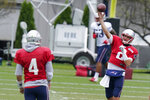 New England Patriots quarterback Brian Hoyer (2) throws to quarterback Jarrett Stidham (4) during an NFL football training camp practice, Thursday Aug. 27, 2020 in Foxborough, Mass. (AP Photo/Steven Senne, Pool)