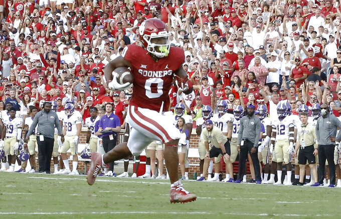 Oklahoma running back Eric Gray (0) scores a touchdown against Western Carolina during the first half of an NCAA college football game Saturday, Sept. 11, 2021, in Norman, Okla. (AP Photo/Alonzo Adams)