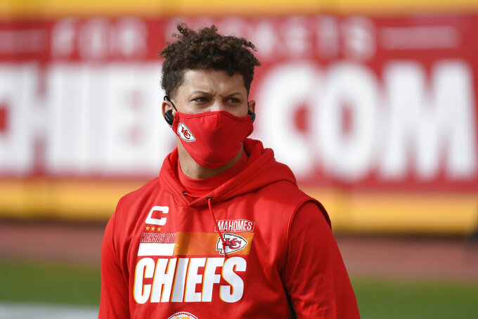 Kansas City Chiefs quarterback Patrick Mahomes walks on the field before an NFL divisional round football game against the Cleveland Browns, Sunday, Jan. 17, 2021, in Kansas City. (AP Photo/Reed Hoffmann)