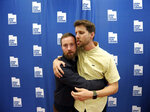 In this May 3, 2019, photo, Aaron Ruell, who played the character Kip, left, and Jon Heder, who played Napoleon Dynamite, hug during a photo-op as they celebrate the 15th anniversary of the cult classic comedy