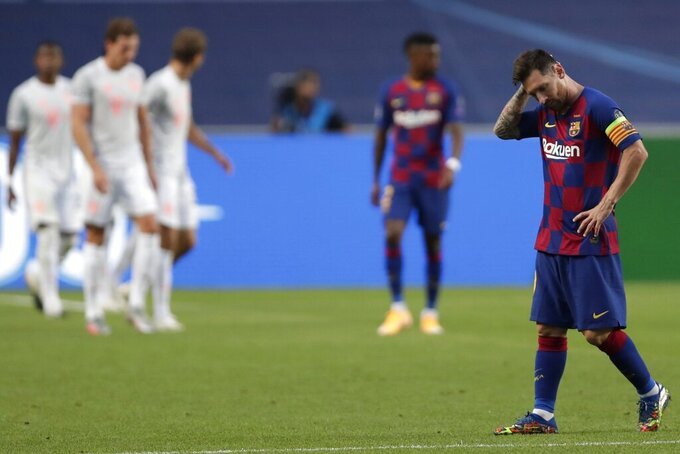 """Barcelona's Lionel Messi holds his head during the Champions League quarterfinal match between FC Barcelona and Bayern Munich at the Luz stadium in Lisbon, Portugal, Friday, Aug. 14, 2020. Gerard Piqué says Barcelona """"hit rock bottom"""" in an 8-2 humiliation from Bayern Munich in the Champions League quarterfinals. It's 74 years since Barcelona conceded eight goals in a game. (AP Photo/Manu Fernandez/Pool)"""