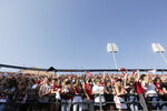 Fans in the Washington State student section react to music played inside Martin Stadium during the first half of an NCAA college football game against Portland State, Saturday, Sept. 11, 2021, in Pullman, Wash. (AP Photo/Young Kwak)