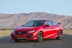 This undated photo provided by Honda shows the 2019 Honda Civic Si. Available as a coupe or sedan, the Si comes with a 205-horsepower engine that provides quick acceleration. (Honda via AP)