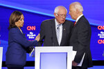 Democratic presidential candidate Sen. Kamala Harris, D-Calif., left, Sen. Bernie Sanders, I-Vt., middle, and former Vice President Joe Biden talk following a Democratic presidential primary debate hosted by CNN/New York Times at Otterbein University, Tuesday, Oct. 15, 2019, in Westerville, Ohio. (AP Photo/John Minchillo)