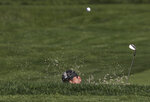 Francesco Molinari, of Italy, hits out of a bunker on the 11th hole during a practice round for the PGA Championship golf tournament, Wednesday, May 15, 2019, at Bethpage Black in Farmingdale, N.Y. (AP Photo/Charles Krupa)