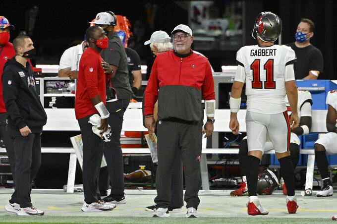 Tampa Bay Buccaneers head coach Bruce Arians smiles form the sidlines during the second half of an NFL football game against the Las Vegas Raiders, Sunday, Oct. 25, 2020, in Las Vegas. (AP Photo/David Becker)