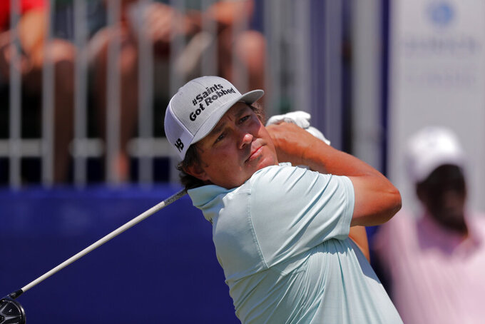 Jason Dufner hits off the first tee during the second round of the PGA Zurich Classic golf tournament at TPC Louisiana in Avondale, La., Friday, April 26, 2019. Dufner's cap refers to the controversial non-call in the NFL NFC Championship football game between the Los Angeles Rams and the New Orleans Saints. (AP Photo/Gerald Herbert)