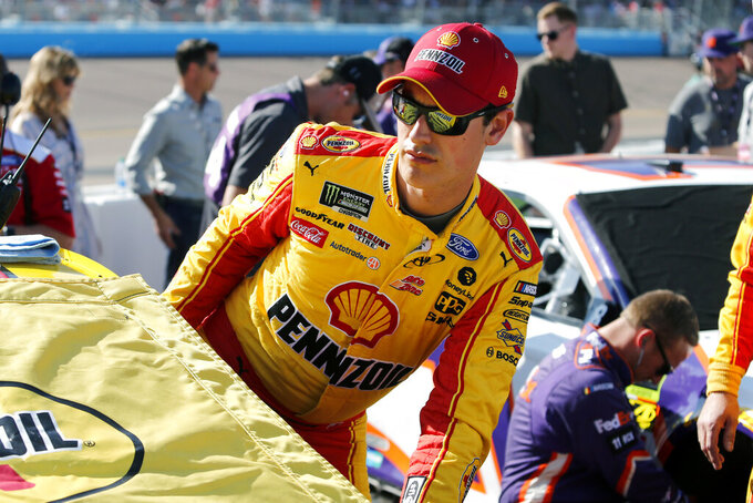Joey Logano climbs into his race car prior to a NASCAR Cup Series auto race at ISM Raceway, Sunday, Nov. 10, 2019, in Avondale, Ariz. (AP Photo/Ralph Freso)