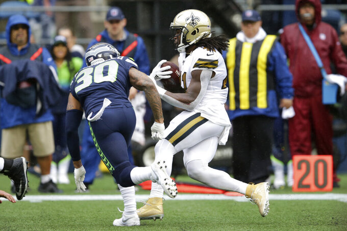New Orleans Saints' Alvin Kamara, right, carries the ball to score after a pass reception as Seattle Seahawks' Bradley McDougald moves in during the first half of an NFL football game, Sunday, Sept. 22, 2019, in Seattle. (AP Photo/Scott Eklund)
