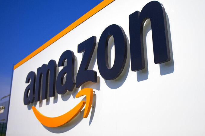 FILE - In this Thursday April 16, 2020 file photo, The Amazon logo is seen in Douai, northern France. Amazon is suing the attorney general of New York in a bid to stop her from suing the company over its coronavirus safety protocols and the firing of one of its outspoken workers, Friday, Feb. 12, 2021. (AP Photo/Michel Spingler, File)