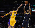 Denver Nuggets forward Wilson Chandler, right, attempts a shot while Los Angeles Lakers forward Kyle Kuzma defends during the first half of an NBA basketball game in Los Angeles, Tuesday, March 13, 2018. (AP Photo/Kelvin Kuo)