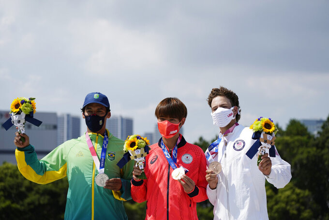 From left, Kelvin Hoefler of Brazil, Yuto Horigome of Japan and Jagger Eton pose after the medal presentation at the men's street skateboarding finals at the 2020 Summer Olympics, Sunday, July 25, 2021, in Tokyo, Japan. (AP Photo/Ben Curtis)