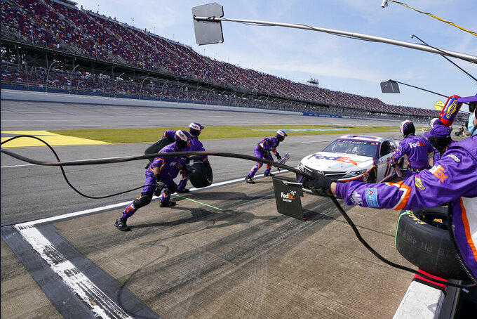 Denny Hamlin pits during the YellaWood 500 NASCAR auto race at Talladega Superspeedway, Sunday, Oct. 4, 2020, in Talladega, Ala. (AP Photo/John Bazemore)