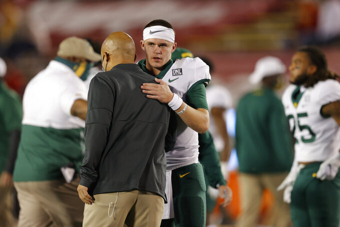Baylor coach Dave Aranda, left, talks with quarterback Charlie Brewer before the team's NCAA college football game against Iowa State, Saturday, Nov. 7, 2020, in Ames, Iowa. (AP Photo/Matthew Putney)