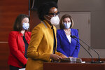 Rep. Lauren Underwood, D-Ill., center, speaks during a news conference with Speaker of the House Nancy Pelosi, D-Calif., right, and Rep. Angie Craig, D-Minn., left, on Capitol Hill in Washington, Friday, March 19, 2021.  (Chip Somodevilla/Pool via AP)