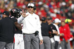 Texas Tech coach Matt Wells talks to a referee during the first half of an NCAA college football game against TCU, Saturday, Nov. 16, 2019, in Lubbock, Texas. (Sam Grenadier/Lubbock Avalanche-Journal via AP)
