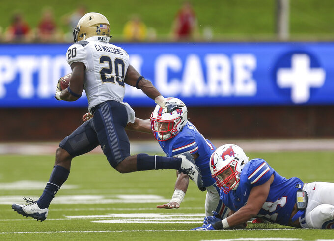 SMU linebacker Richard Moore (14) and safety Elijah McQueen (6) works to bring down Navy tight end CJ Williams (20) during the second quarter of an NCAA college football game, Saturday, Sept. 22, 2018, at Gerald J. Ford Stadium in Dallas. (Ryan Michalesko/The Dallas Morning News via AP)