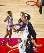 Las Vegas Aces center JiSu Park (19) shoots while fouled by New York Liberty forward Reshanda Gray (1) during the second quarter of a WNBA basketball game Thursday, June 17, 2021, in Las Vegas. (L.E. Baskow/Las Vegas Review-Journal via AP)