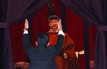 Japan's Prime Minister Shinzo Abe raises his hands as he shouts