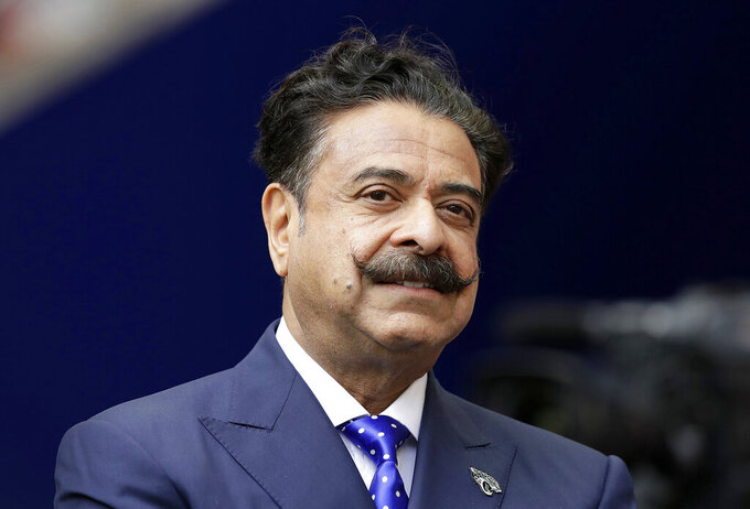 "FILE - This file  Sept. 24, 2017 file photo shows Shad Khan at Wembley Stadium in London.  The Jacksonville Jaguars will play two home games in London next season, strengthening the franchise's foothold in an overseas market the NFL is eager to expand. The Jaguars will play back-to-back games at historic Wembley Stadium, giving them a potential ""home-field"" advantage in the second one since they won't have to travel that week. Specific dates were not announced.(AP Photo/Matt Dunham, FILE)"