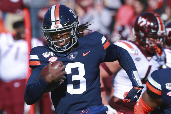 Virginia quarterback Bryce Perkins (3) heads to the end zone for a touchdown during the first half of an NCAA college football game against Virginia Tech in Charlottesville, Va., Friday, Nov. 29, 2019. (AP Photo/Steve Helber)