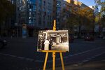 In this Tuesday, Nov. 6, 2018 photo a Nov. 10, 1938 photo from the AP Archive, showing by Nazis destroyed shops at the Potsdamer Strasse street, is placed at the same location 80 years later in Berlin, Germany.  On Nov. 9, 1938 Jews and their holdings were attacked across Nazi Germany - also known as Kristallnacht or Night of the broken glasses. (AP Photo/Markus Schreiber)