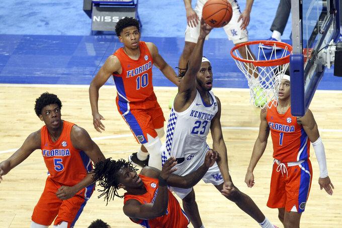 Kentucky's Isaiah Jackson (23) shoots near Florida defenders Omar Payne (5), Anthony Duruji (4),Noah Locke (10) and Tre Mann (1) during the second half of an NCAA college basketball game in Lexington, Ky., Saturday, Feb. 27, 2021. (AP Photo/James Crisp)