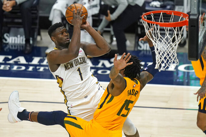 New Orleans Pelicans forward Zion Williamson (1) shoots as Utah Jazz center Derrick Favors (15) defends during the first half of an NBA basketball game Tuesday, Jan. 19, 2021, in Salt Lake City. (AP Photo/Rick Bowmer)