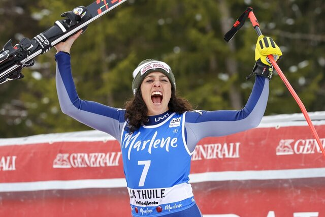 FILE -- In this Feb. 29, 2020 file photo, Italy's Federica Brignone celebrates taking second place in an alpine ski, women's World Cup Super G, in La Thuile, Italy. Amid a worldwide suspension of sports events, Brignone was awaiting a special delivery which arrived last month, with three crystal globes: the big 9-kilogram (20-pound) prize for her first overall World Cup triumph — she's the first Italian woman to win the coveted honor in the 53-year history of the competition -- plus two smaller 3.5-kilogram (8-pound) globes for her season-long giant slalom and Alpine combined titles. (AP Photo/Alessandro Trovati)
