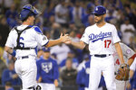 Los Angeles Dodgers catcher Will Smith, left, and relief pitcher Joe Kelly celebrate the team's 6-0 win over the Washington Nationals in Game 1 in baseball's National League Divisional Series on Thursday, Oct. 3, 2019, in Los Angeles. (AP Photo/Mark J. Terrill)