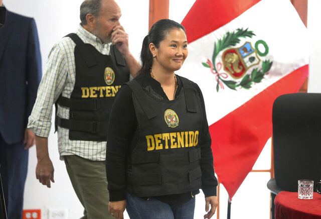 FILE - In this Oct. 17, 2018 file photo, Keiko Fujimori, the daughter of Peru's former President Alberto Fujimori, and leader of the opposition party, enters to the courtroom wearing a chest vest that reads in Spanish: