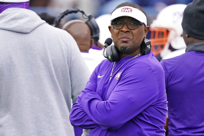 Edward Waters football coach Greg Ruffin looks at the scoreboard during the second half of an NCAA college football game against Jackson State in Jackson, Miss., Sunday, Feb. 21, 2021. (AP Photo/Rogelio V. Solis)