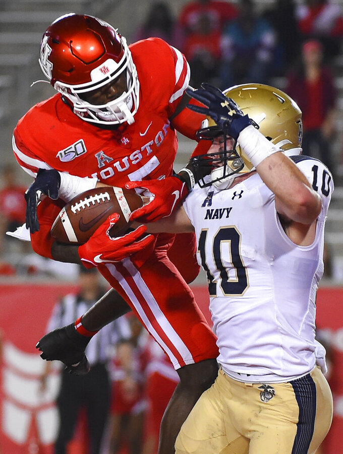 Navy safety Kevin Brennan (10) intercepts a pass n the end zone intended for Houston wide receiver Marquez Stevenson during the second half of an NCAA college football game, Saturday, Nov. 30, 2019, in Houston. (AP Photo/Eric Christian Smith)