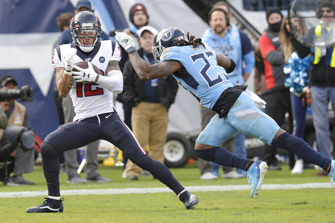 Houston Texans wide receiver Kenny Stills (12) catches a 16-yard touchdown pass as he is defended by Tennessee Titans cornerback Tye Smith (23) in the first half of an NFL football game Sunday, Dec. 15, 2019, in Nashville, Tenn. (AP Photo/Mark Zaleski)